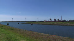 Pan industrial landscape Royal Dutch Steelworks at North Sea Canal + pan Stock Footage