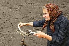 Stock Photo of elderly woman with bike