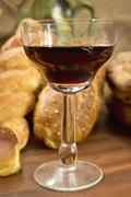 Stock Photo of still life assortment of bread with a glass of red wine.