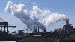 Industrial landscape Royal Dutch Blast Furnaces and Steelworks + zoom out port Stock Footage