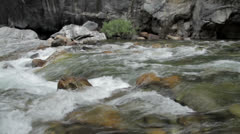 Rapid flowing water down a fresh water stream Stock Footage