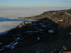 Shadow of Ob Hill covers McMurdo Station - stock photo