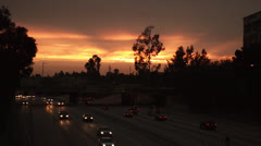 Los Angeles sunset, cars on highway Stock Footage