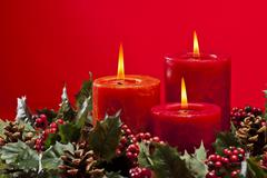 Red advent wreath with candles Stock Photos
