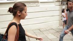 Young Woman Walking in an Urban Stock Footage