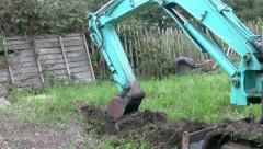 A mini digger at work Stock Footage