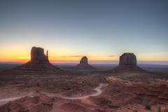 Monument valley holiday destination backlit by sunrise Stock Photos