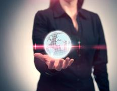Woman Holding Globe with Laser Lens Flare Stock Photos