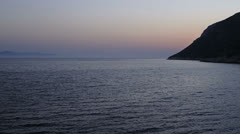 Night falls over the coast in Dubrovnik archipelago Stock Footage
