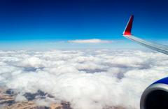 View from the window of an airplane flying Stock Photos