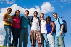 group of diverse students/friends outside - stock photo