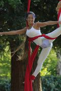 acrobat in a park - stock photo