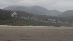 Cannon Beach Oregon Oceanfront at Lowtide One Early Foggy Morning Stock Footage