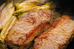 beef tenderloin with endives - stock photo