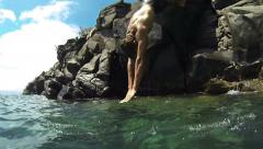Cliff Diving Off Rocks Stock Footage