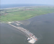 Aerial view ferry quay island of Ameland, Wadden Sea Stock Footage