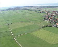 Aerial view village of Buren on the island of Ameland, Wadden Sea Stock Footage