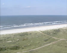 Stock Video Footage of Aerial view North Sea beach ridge, sea at Ameland, The Netherlands