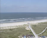 Stock Video Footage of Aerial view North Sea beach ridge + bike path in dune landscape
