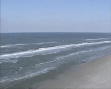 Aerial view North Sea beach ridge + birds in flight Stock Footage