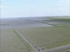 Aerial view land reclamation at Holwerd in tidal marsh of Wadden Sea Stock Footage