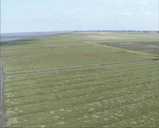 Aerial view land reclamation in tidal marsh, Wadden Sea Stock Footage