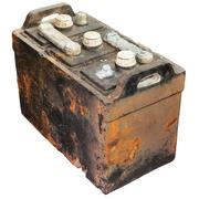 Rusty old car battery isolated on white Stock Photos
