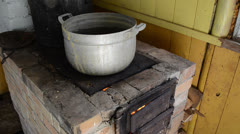 huge dirty pot stand rural kitchen stove furnace firewood burn - stock footage