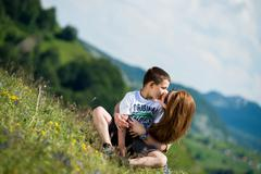 mother with son sitting and spreading love - stock photo