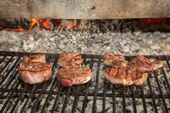 Sirloin steaks on grill Stock Photos