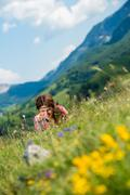 Beautiful women laughing and lying on the grass Stock Photos