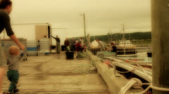 Lobster fishermen with their catch in a harbor Stock Footage