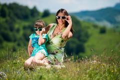 Mother and daughter wearing sunglasses Stock Photos