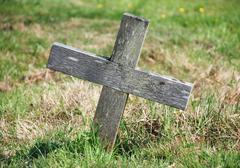 Wooden cross marking a grave Stock Photos