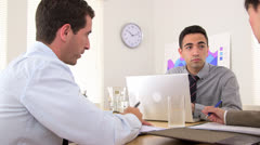 Three business partners talking at a meeting - stock footage
