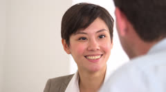Happy Asian businesswoman talking in a meeting Stock Footage