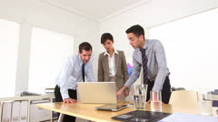Multi-ethnic businessteam working on a laptop Stock Footage
