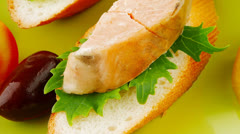 Fried salmon chunks on baguette Stock Footage