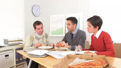 multi-ethnic businessteam working during lunch - stock footage