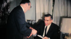 Two Men Joking Around With Christmas Gifts-1962 Vintage 8mm film Stock Footage