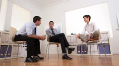 Multi-ethnic business team talking in the office - stock footage