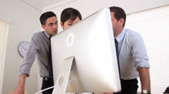 Three business partners working on a computer - stock footage