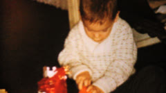 Little Boy Gets Toy Car For Christmas-1962 Vintage 8mm film - stock footage