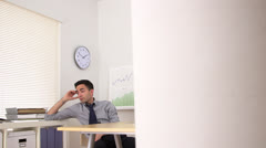 Uninterested Mexican businessman Stock Footage