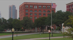 Dealy Plaza, School Book Depository & grassy knoll Stock Footage