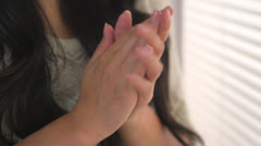 Worried Japanese woman holding her hands Stock Footage