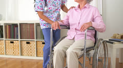 Japanese caregiver talking to patient - stock footage
