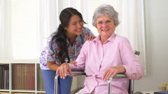 Sweet mature woman and her Asian caregiver - stock footage