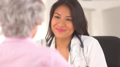 Japanese doctor enjoying a conversation with her patient Stock Footage