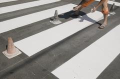 Stock Photo of crosswalk repairing
